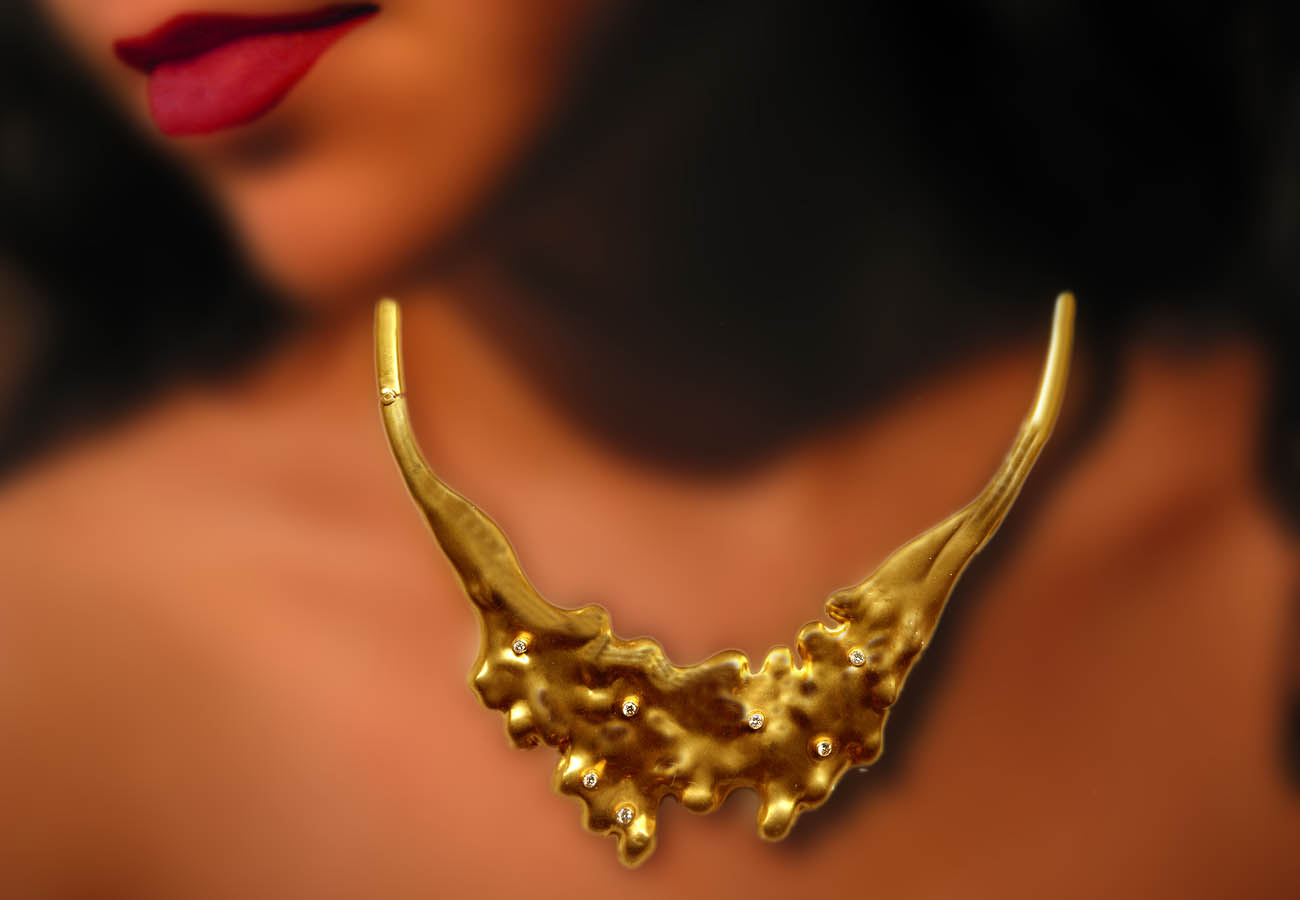 18k gold necklace decorated with diamonds, Inspiration from nature and the movement of lava