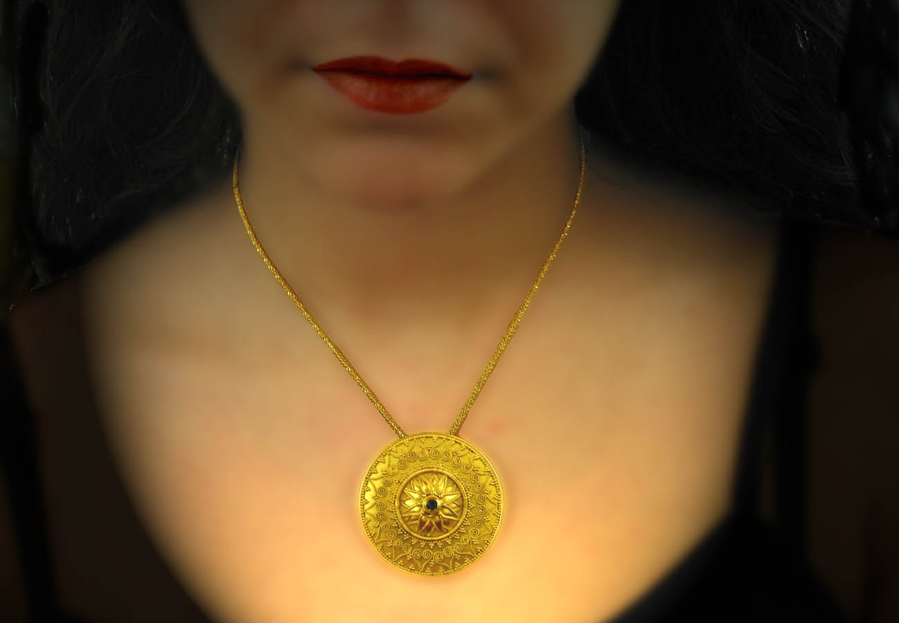 22k gold chain necklace with disk like ending, artistically decorated with specks and precious stones