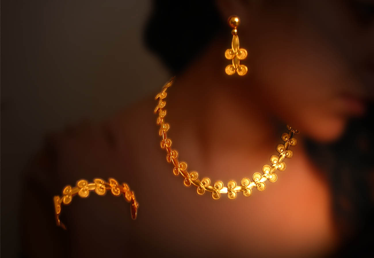 22k gold creation of repeated motifs inspired from the ancient greek period