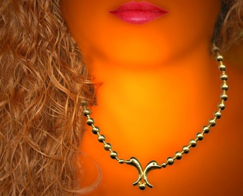 22k gold necklace inspired by the Minoan period rich wall decorations with marine life themes