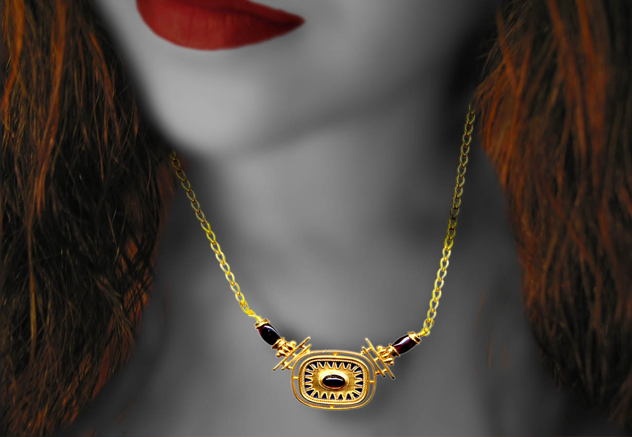 22k gold necklace with chain and amulet decorated with semi-precious stones and enamel