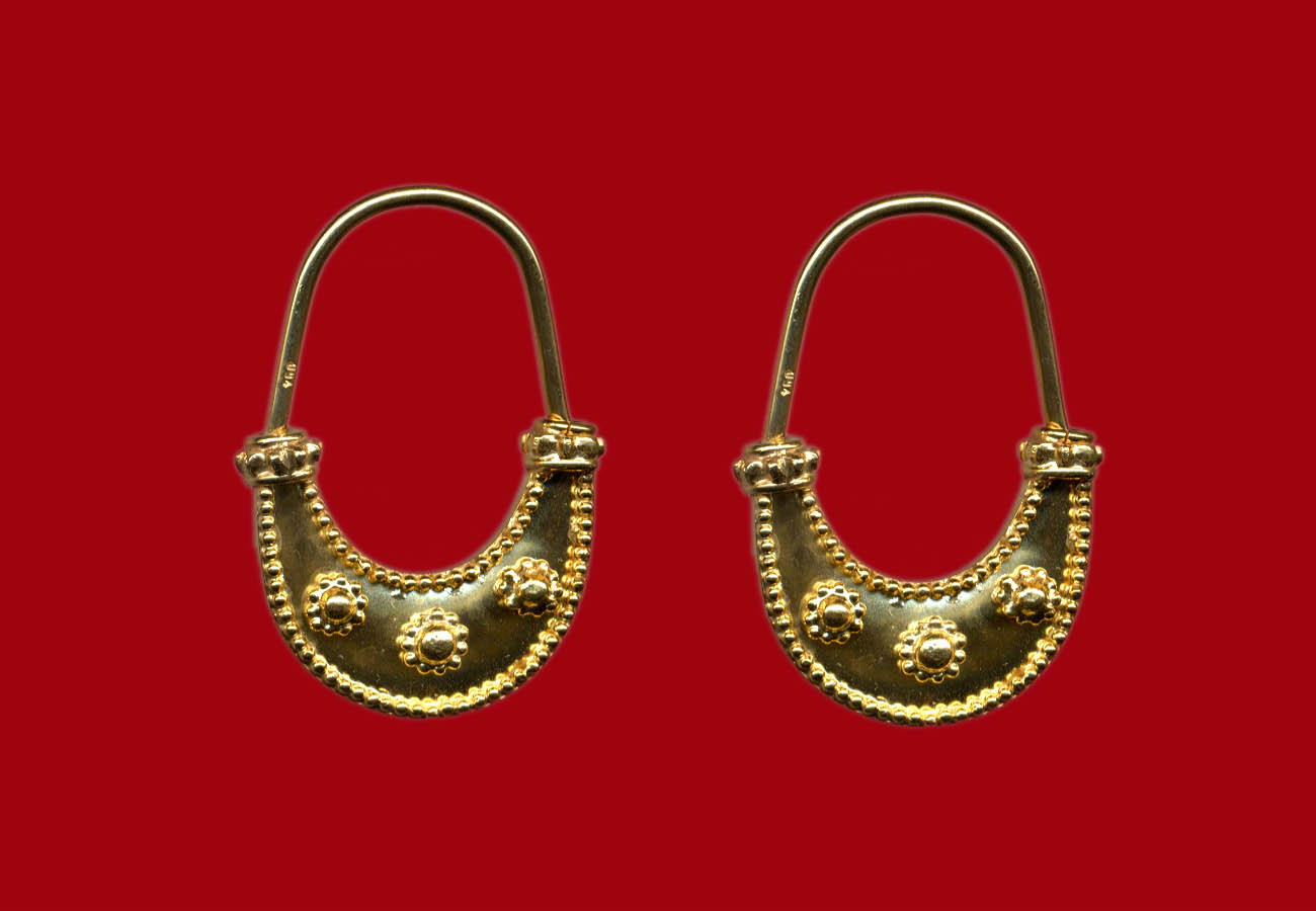 Boat-shaped earrings with granulated circles, late 6th century BC