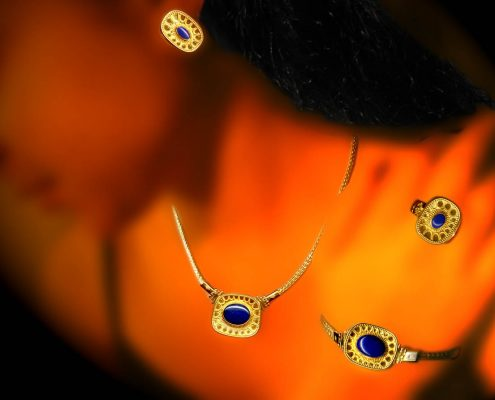 Creation in 18k gold with chain strap and amulet embellished with wire designs, speckles and semi-precious stones