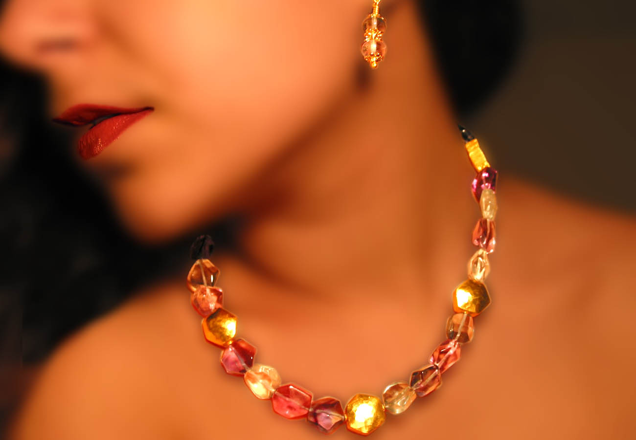 Creation in 22k gold with semi-precious stones