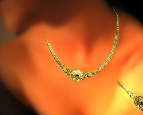 Creation with chain strap in 18k yellow gold decorated with wire designs, speckles and precious stones