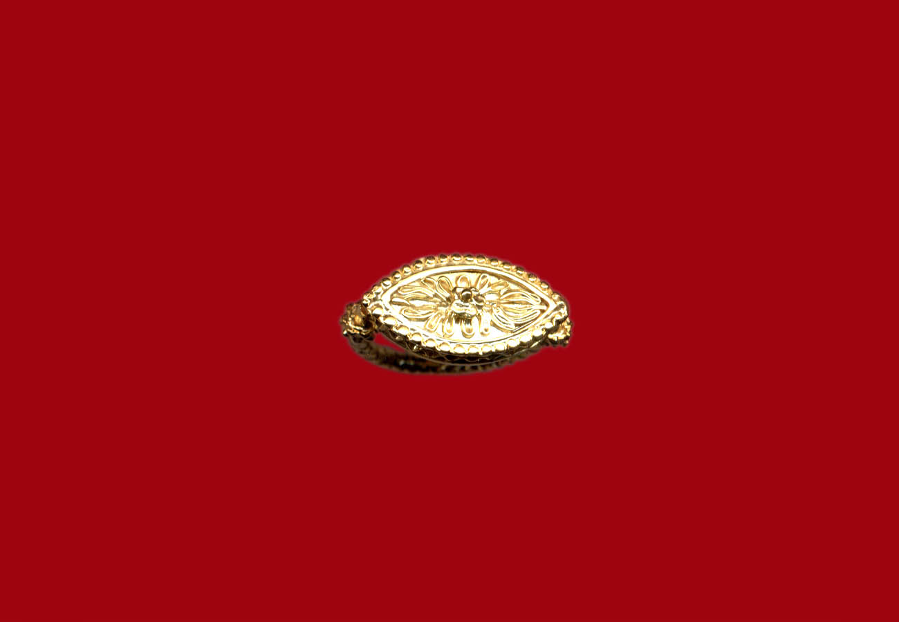 Gold finger ring with bifacial palmette bezel late 5th century BC