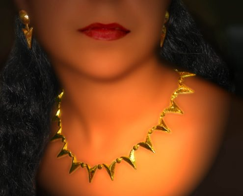 22k gold necklace presented in plain geometric lines