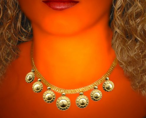 22k gold necklace with chain strap and repeated disk like motif